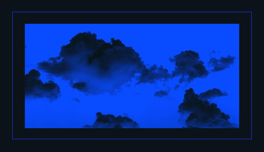 blue sky with dark clouds